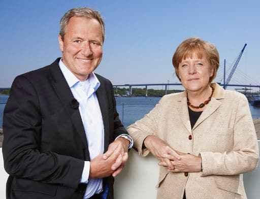Frank Baumann und Bundeskanzlerin Angela Merkel (c) SRF