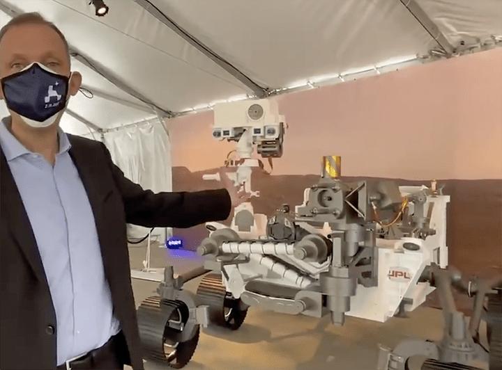 Thomas H. Zurbuchen beside the mars perseverance rover at NASA