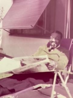 Joe Turner reading the newspaper in 1965